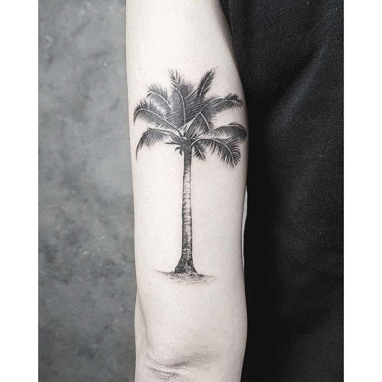 back bicep tattoo palm tree