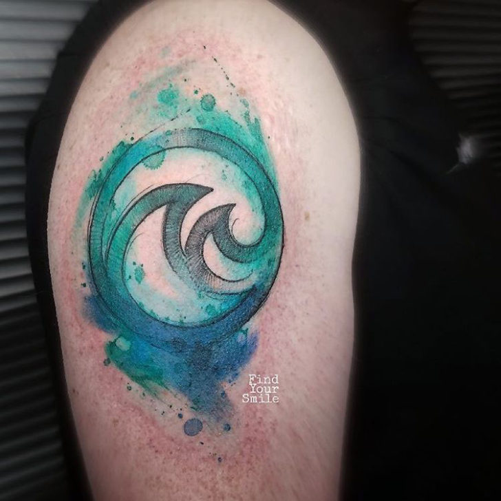 disney themed tattoo the living seas emblem