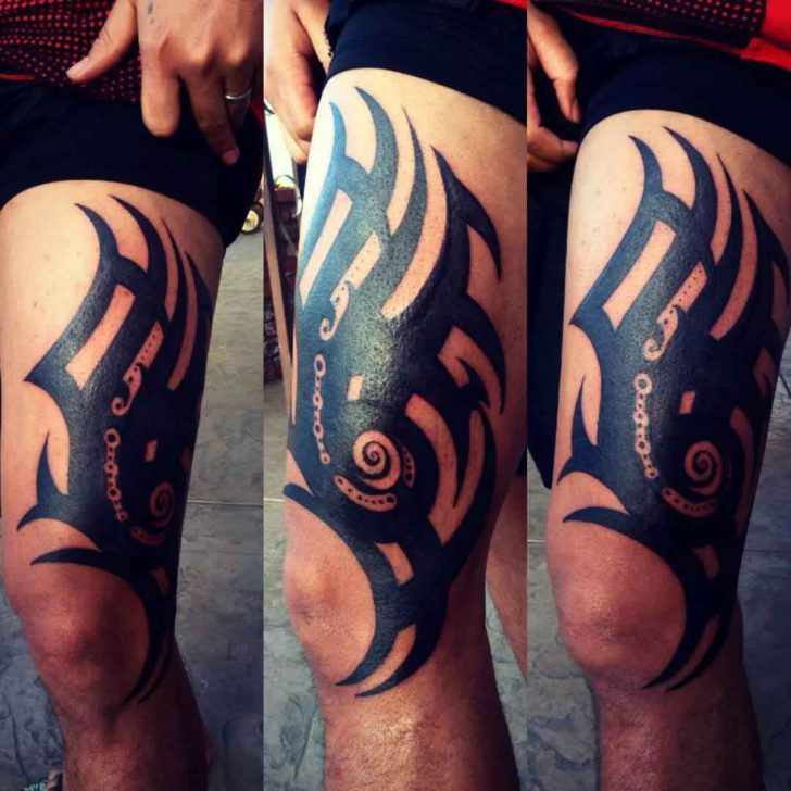 thigh tattoo tribal style