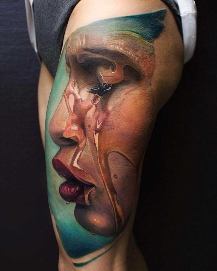 realistic tattoo on thigh side face with water flood