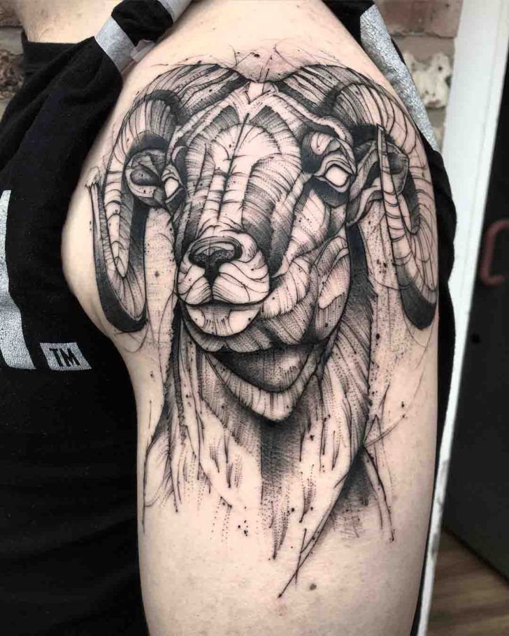 black and grey ram tattoo on shoulder