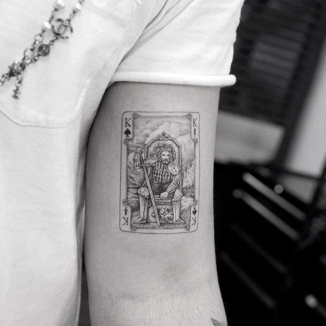 bicep tattoo card king