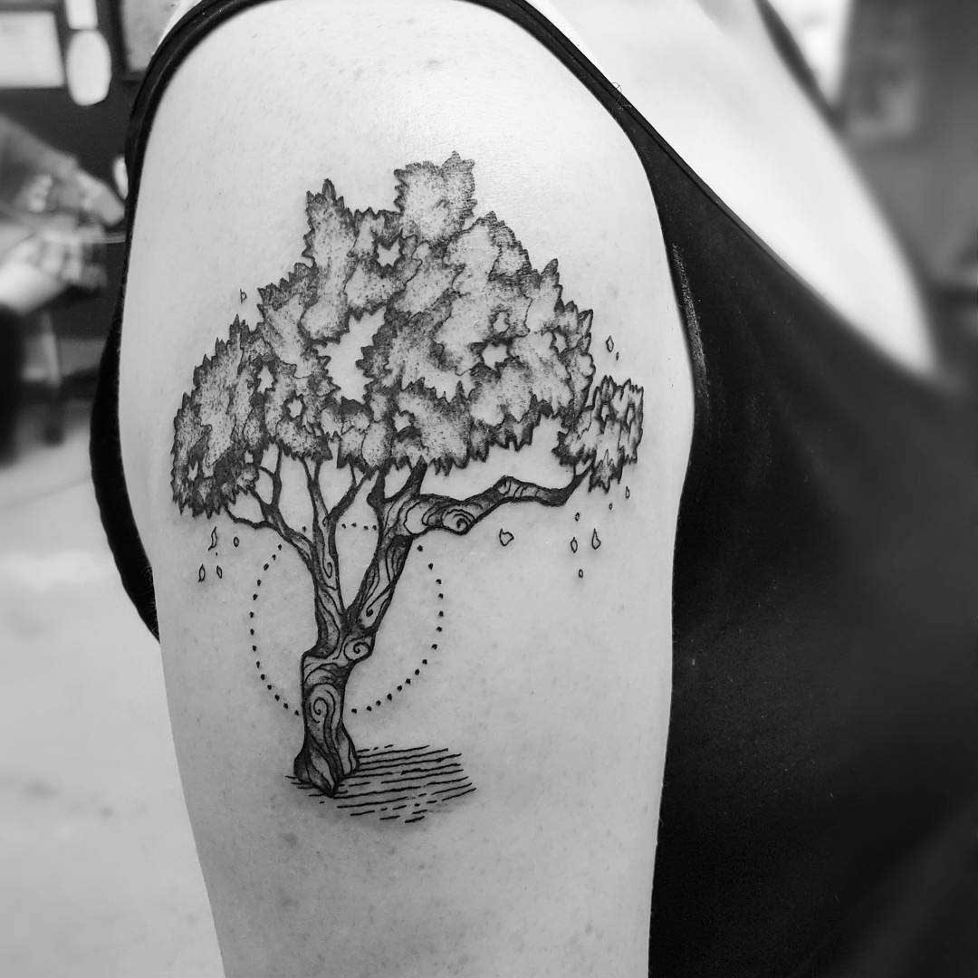 bkack and grey tree tattoo on shoulder