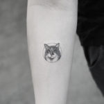 Small Cat Tattoo on Arm
