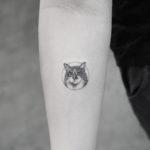 Small Cat Tattoo on Arm