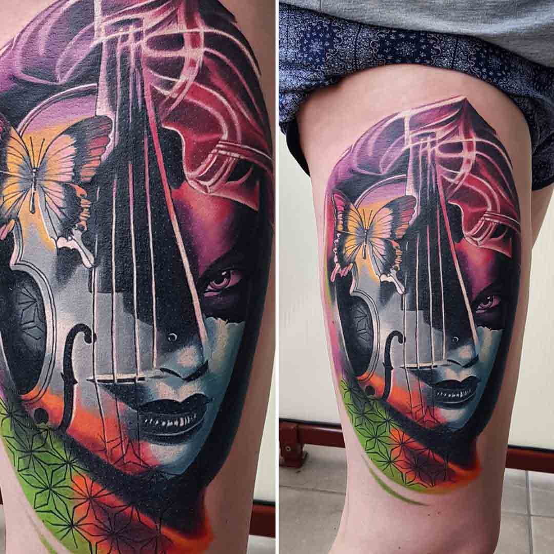 musician tattoo on thigh