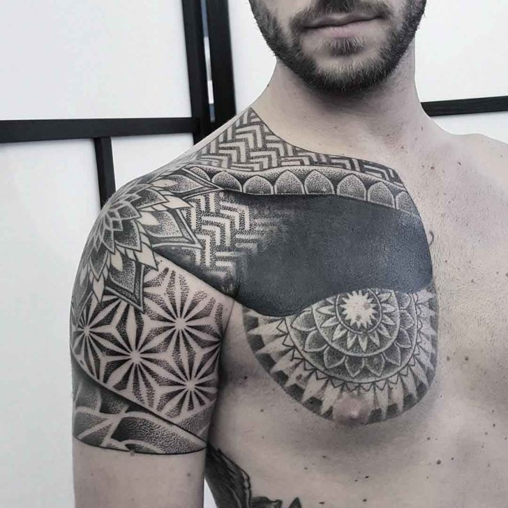 dotwork chest tattoo to shoulder