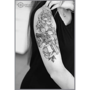 Shoulder Tattoo Flowers and Gun
