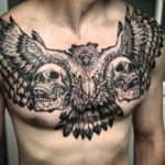 Two Skulls and Bird Chest Tattoo