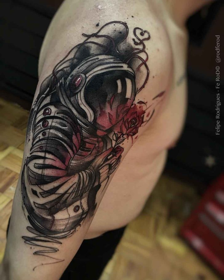 shoulder astronaut tattoo with red rose