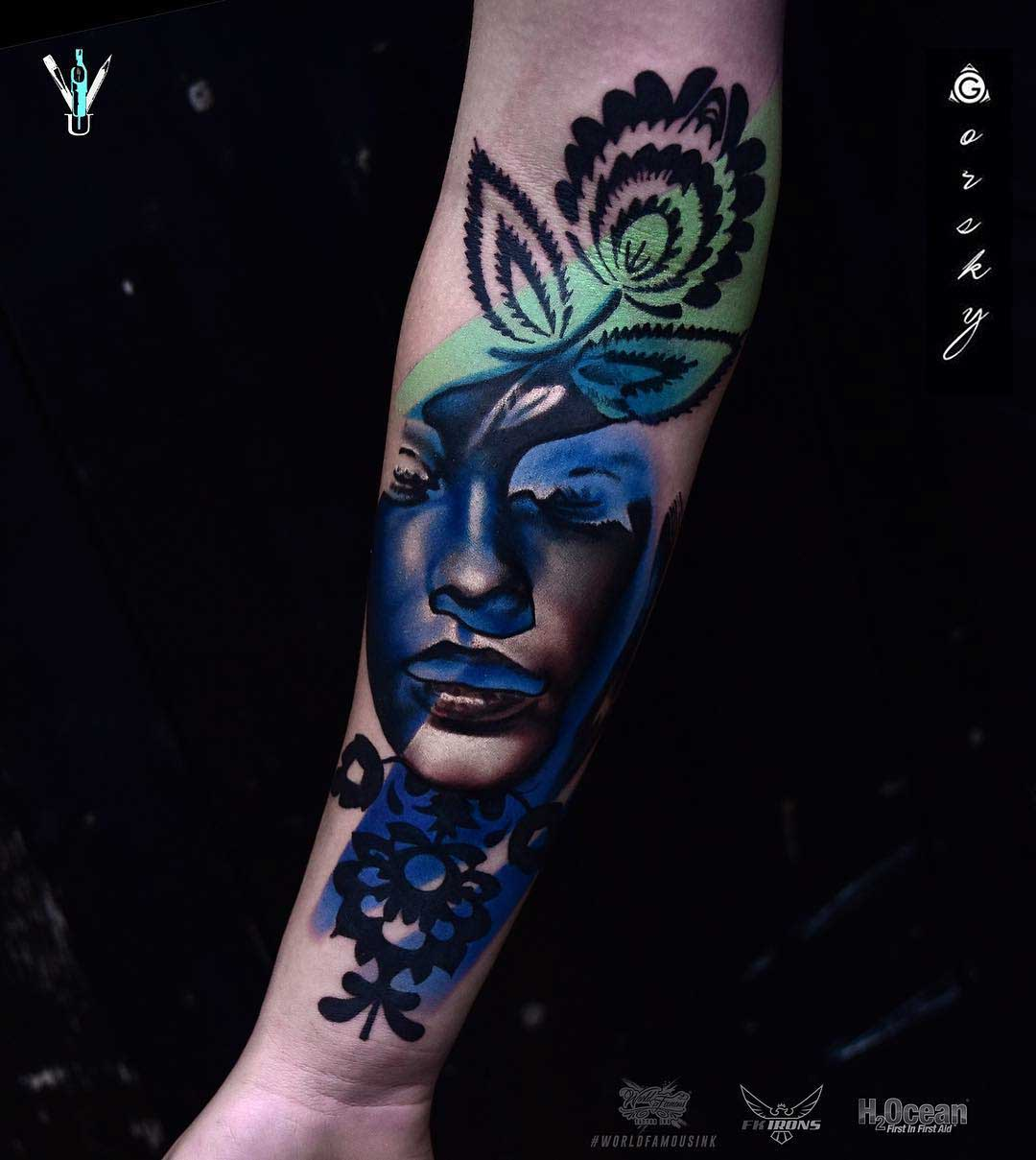 arm tattoo abstract portrait with flower
