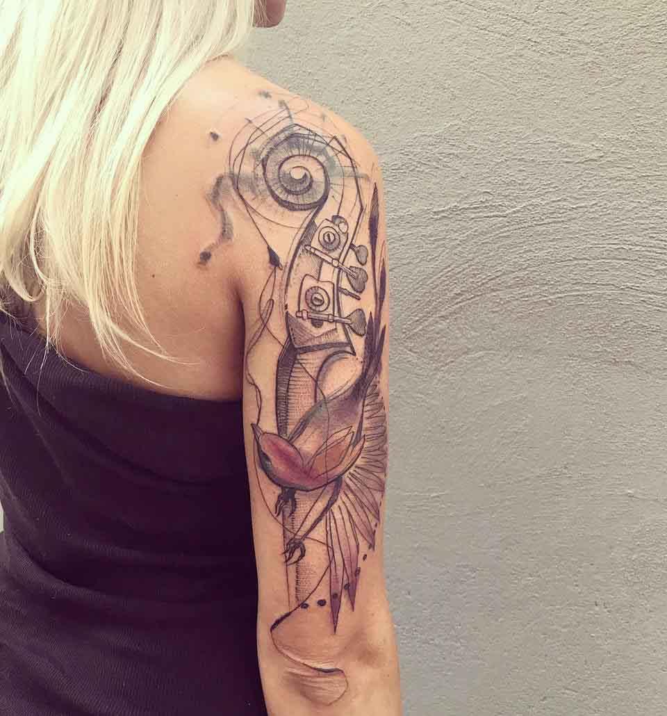 shoulder bass tattoo