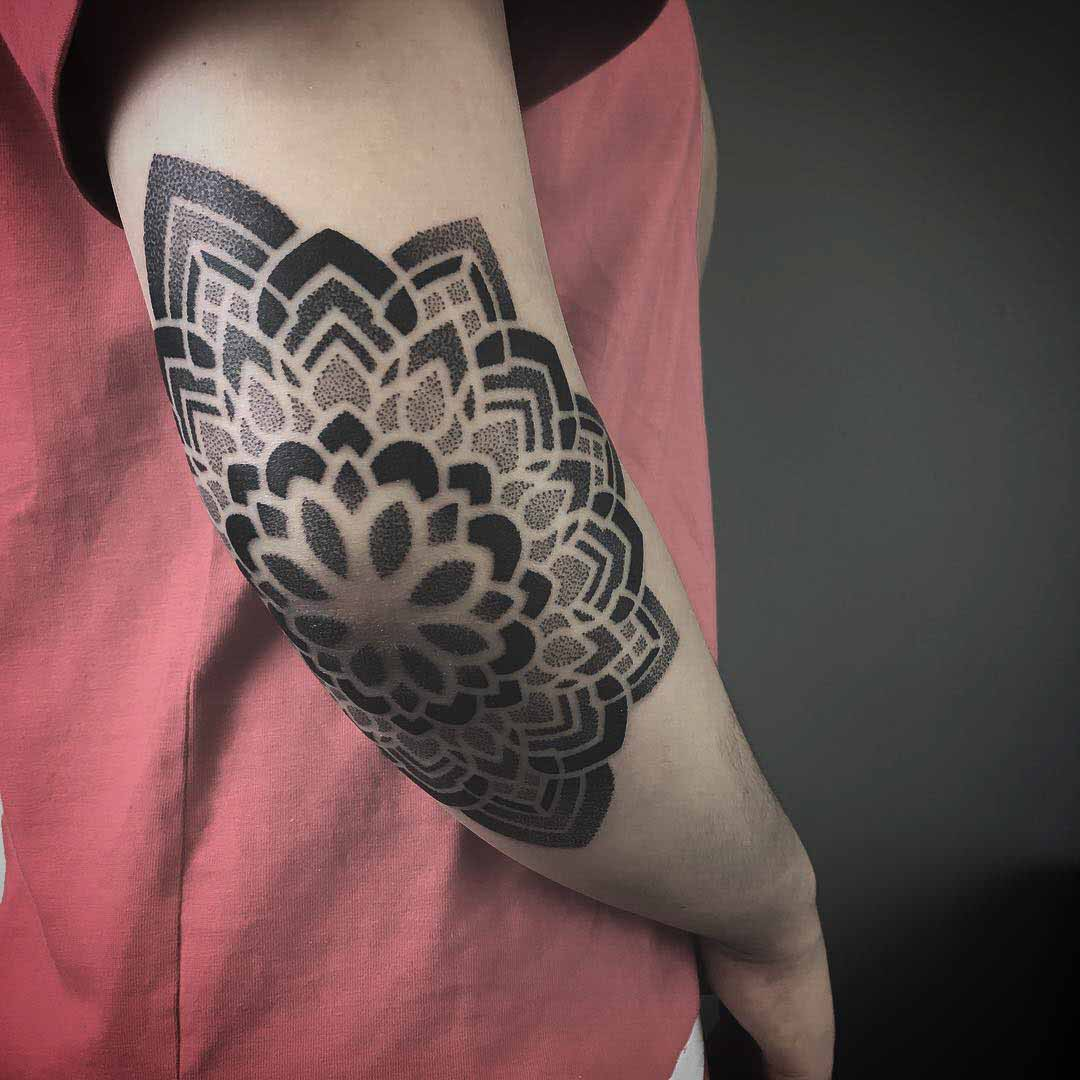 dotwork mandala tattoo on elbow