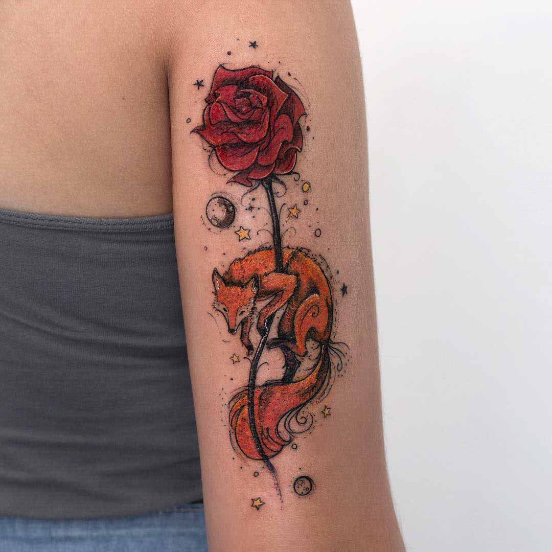 arm tattoo fox and rose