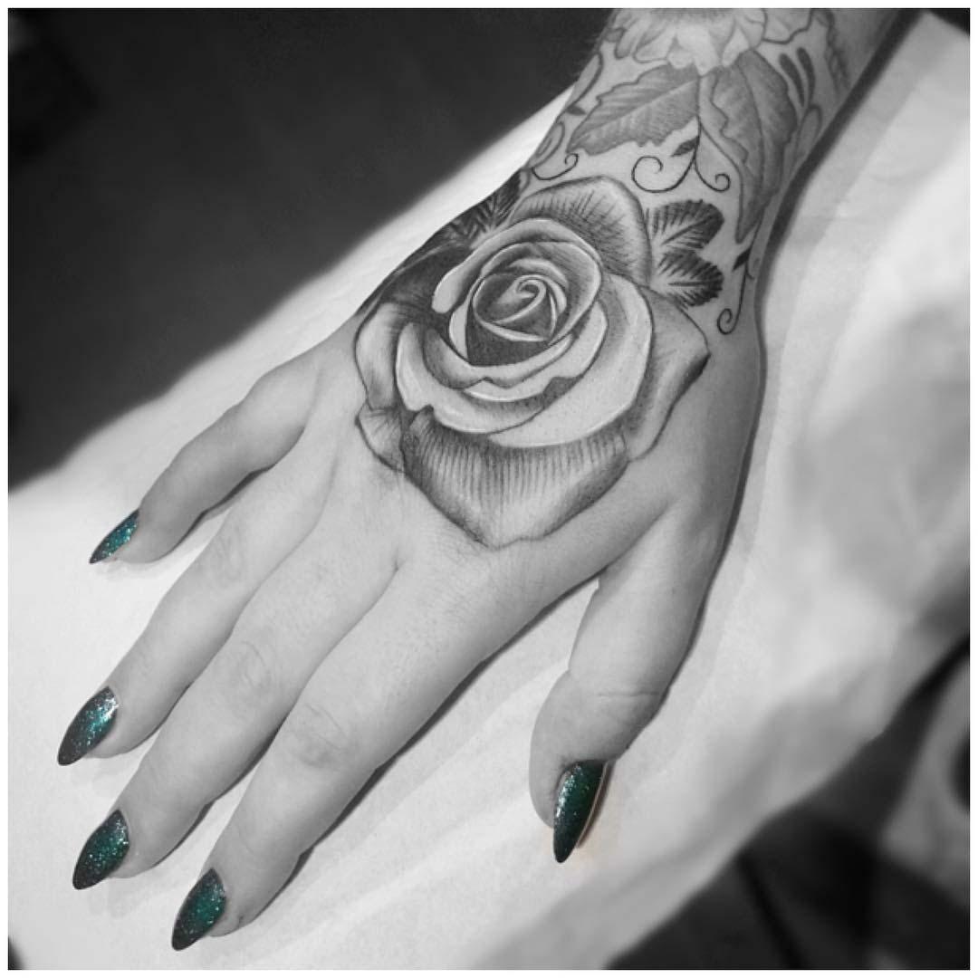 rose tattoo on hand