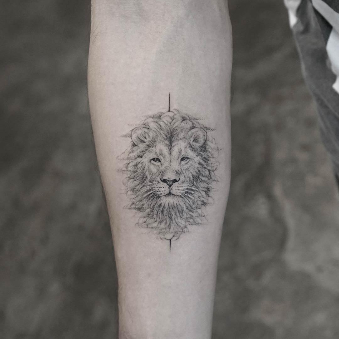 arm tattoo lion head