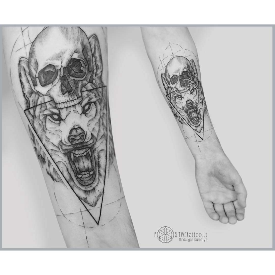 arm tattoo wolf and skull