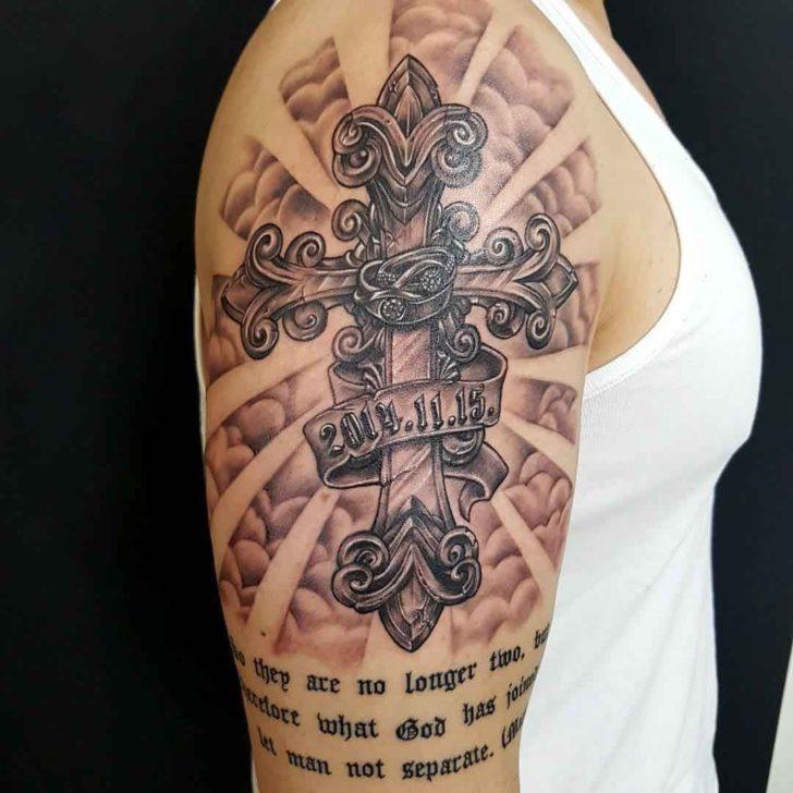 shoulder crucifix tattoo