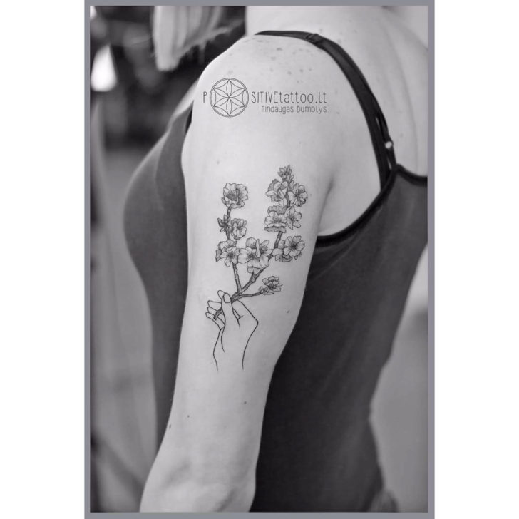 shoulder tattoo branch in bloom