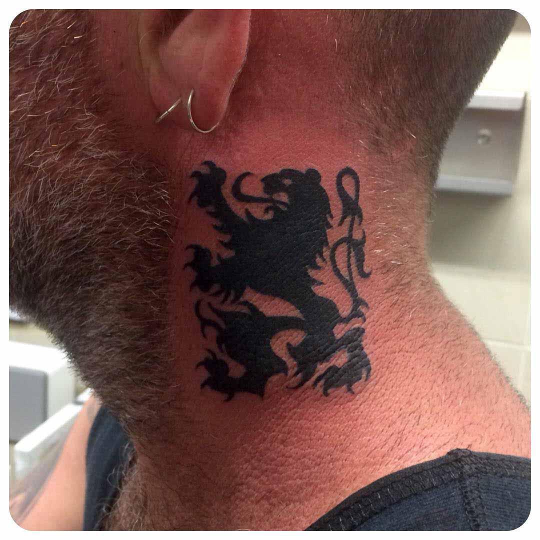 heraldic lion tattoo on neck