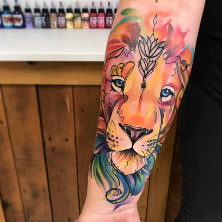 arm tattoo lion face watercolor tattoo style