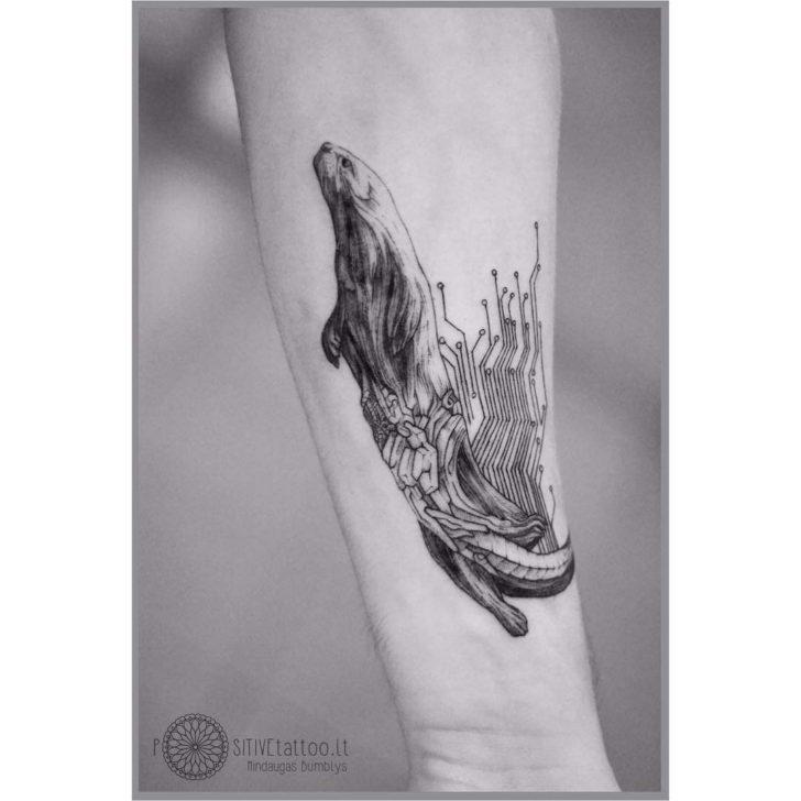 Arm tattoo otter