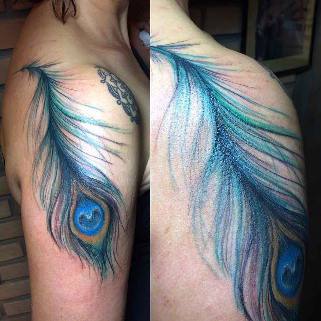 upper shoulder tattoo peacock feather