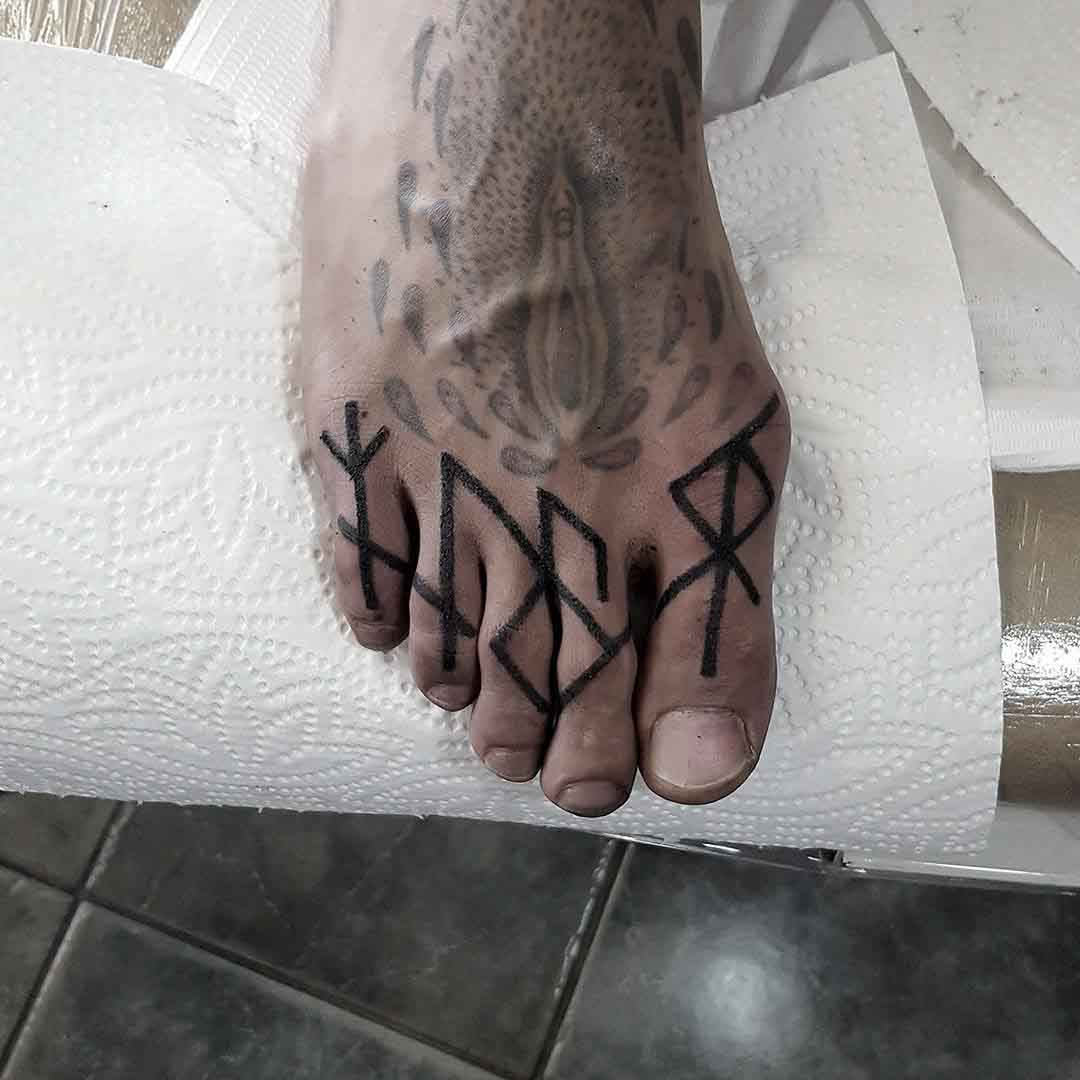 toes tattoo runes