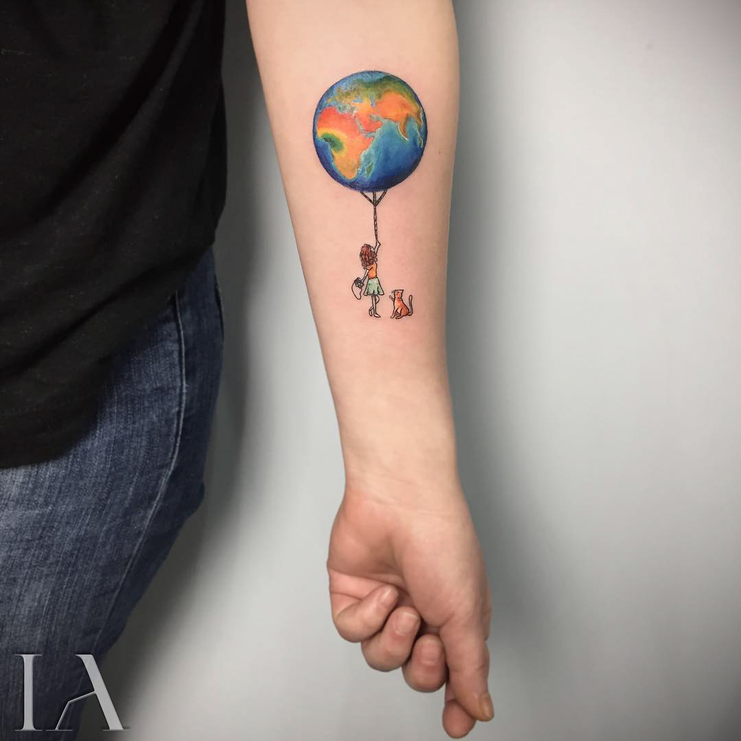 balloon earth tattoo on arm