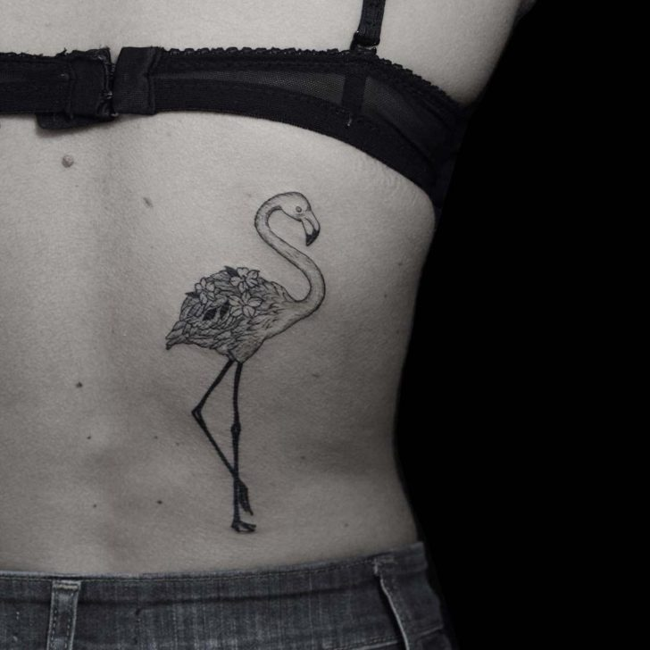 floral flamingo tattoo on back side