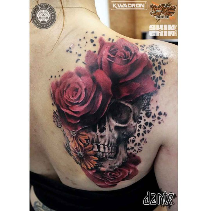 skull tattoo on shoulder blade with roses