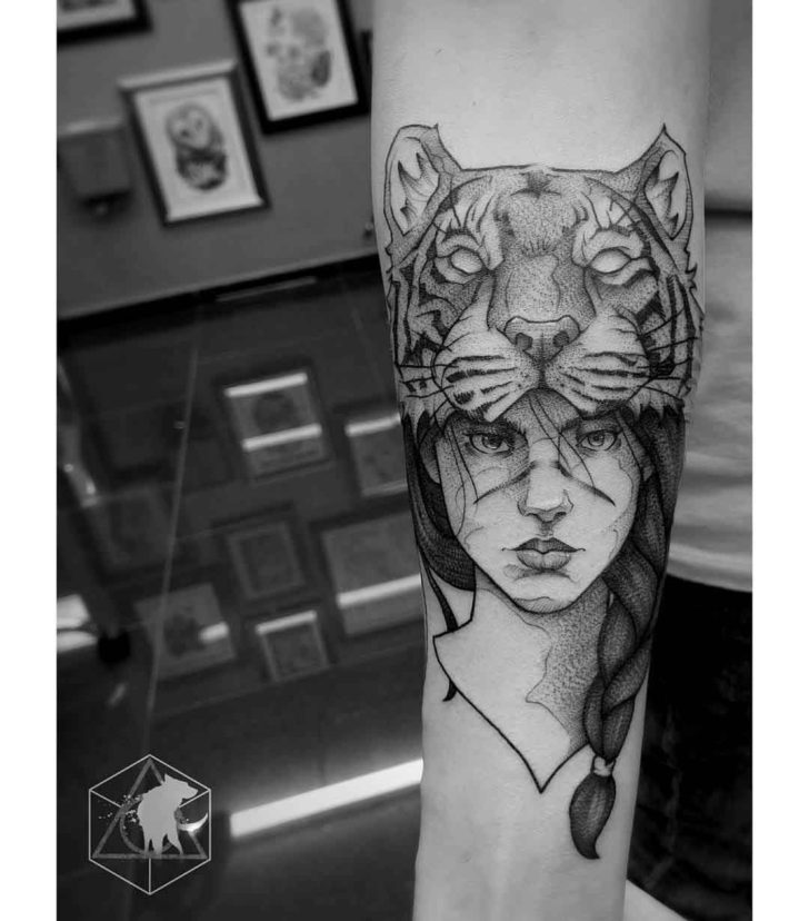 arm tattoo girl in tiger skin