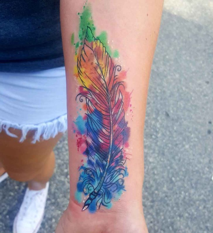 arm tattoo feather watercolor style