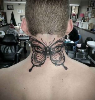 Butterfly With Eyes Tattoo