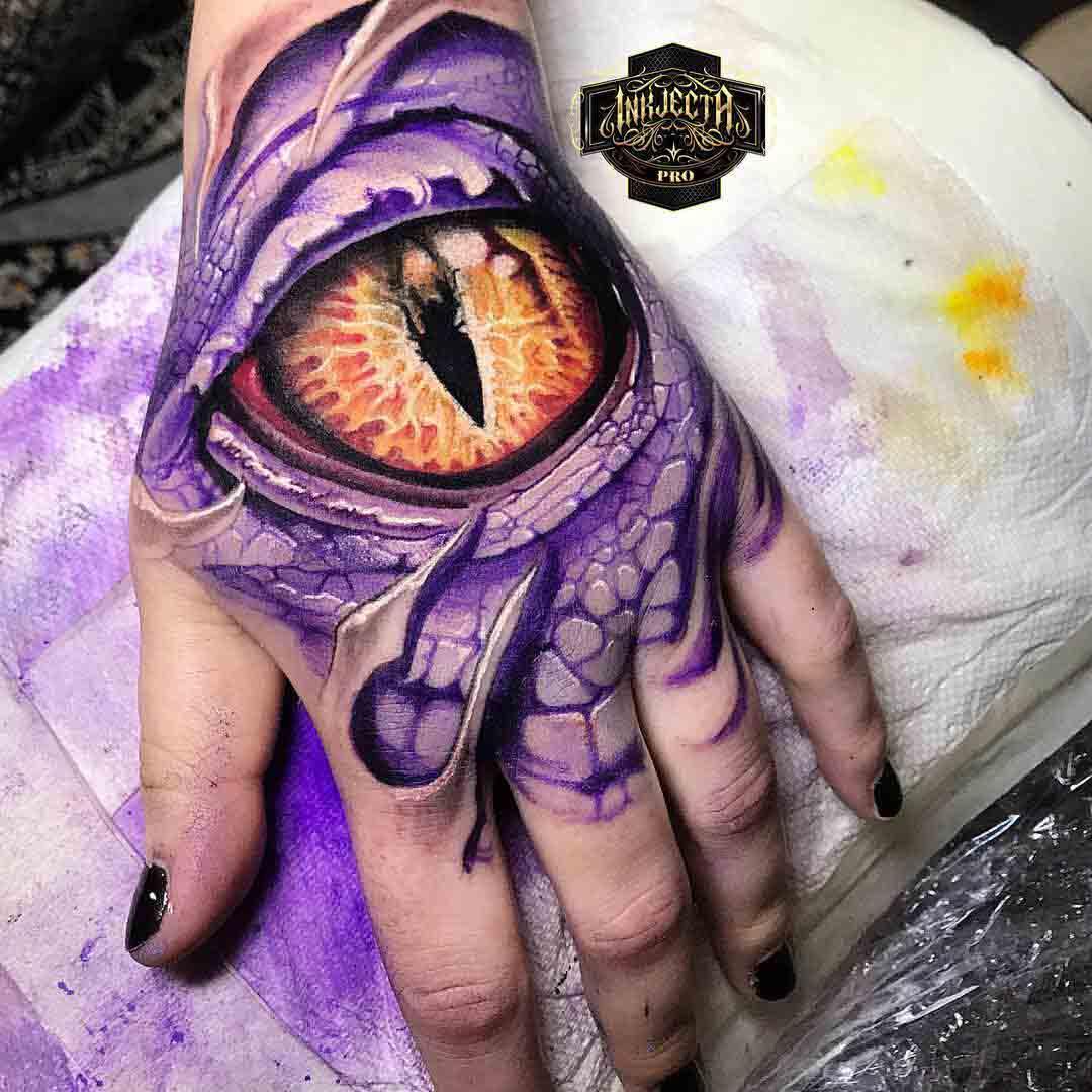 hand tattoo eye of a dragon