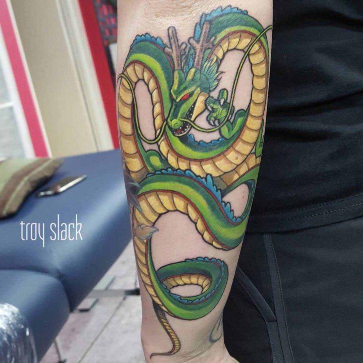 arm tattoo green dragon