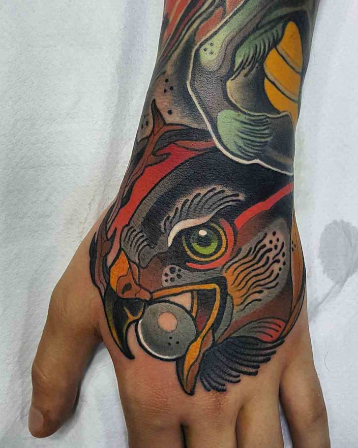 hawk tattoo on hand traditional style