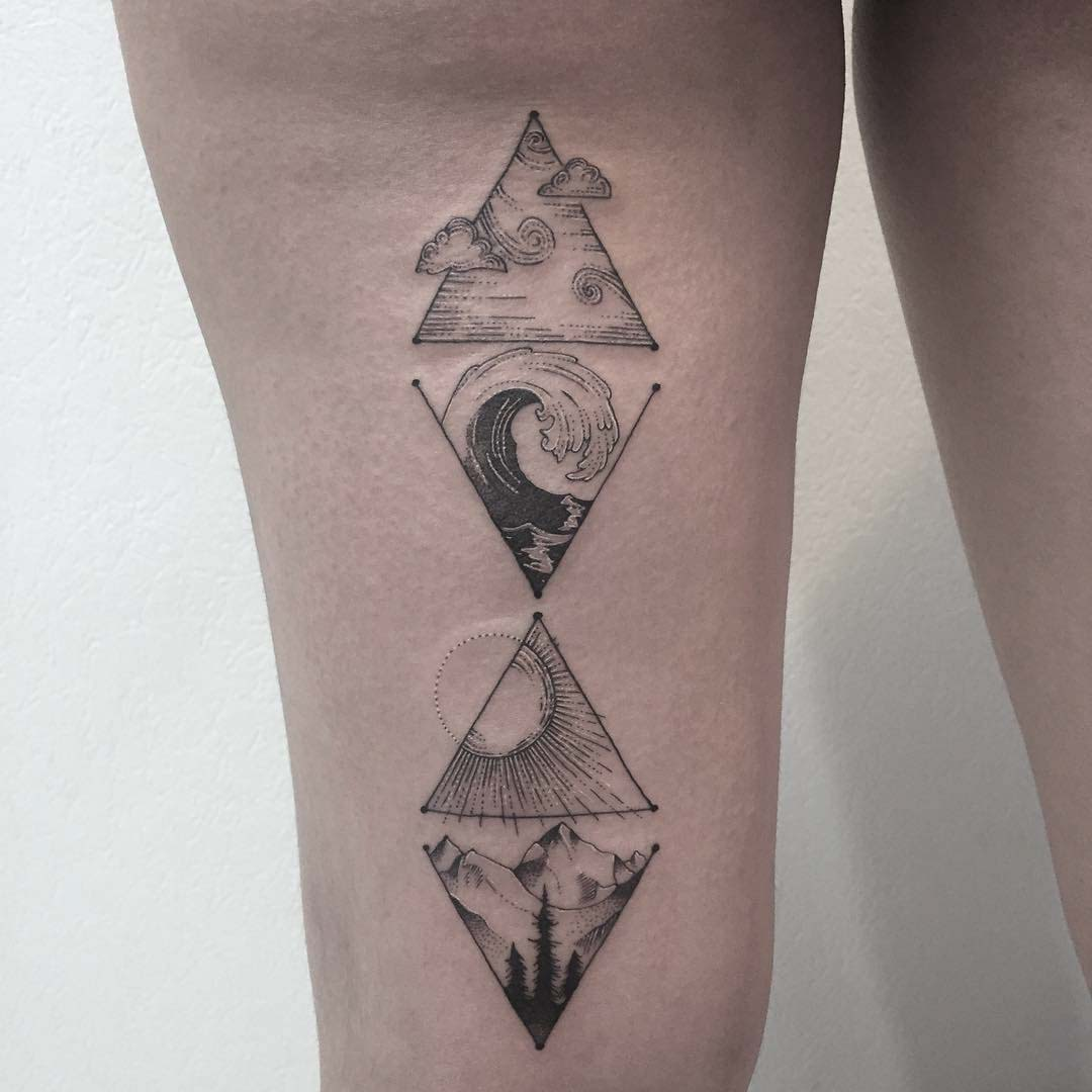 back hip tattoo mountains and ocean