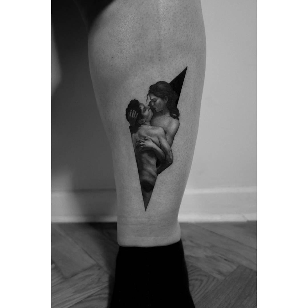 passionate hugs tattoo on calf