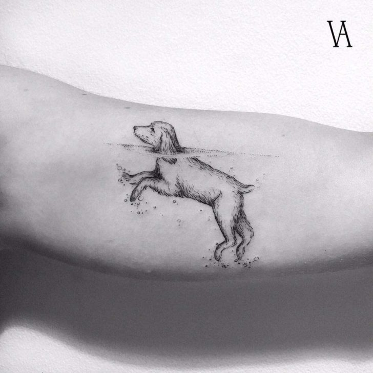 arm tattoo dog swimming