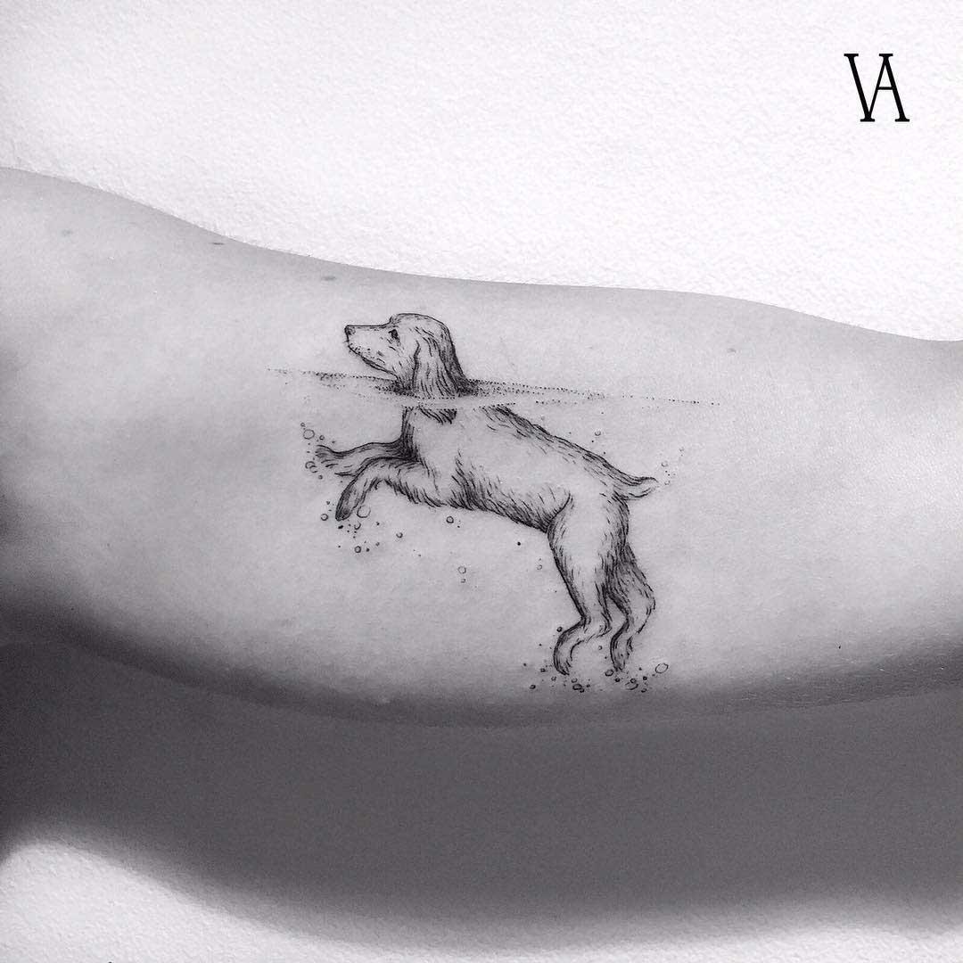 arm tattoo dog swimming