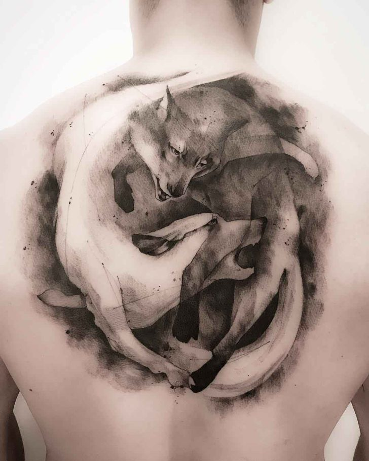 back tattoo wolves ying yang