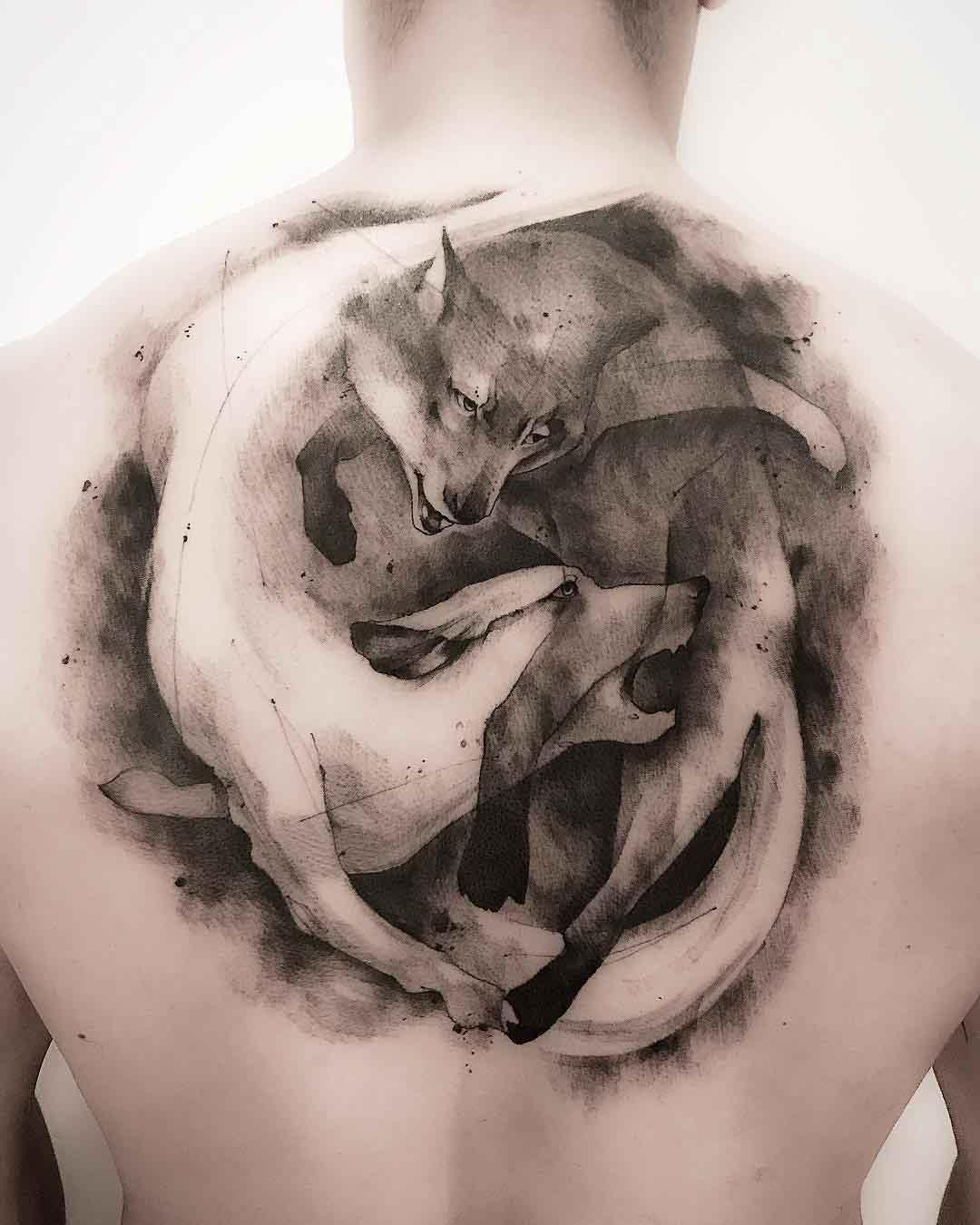 back tattoo wolves ying yang