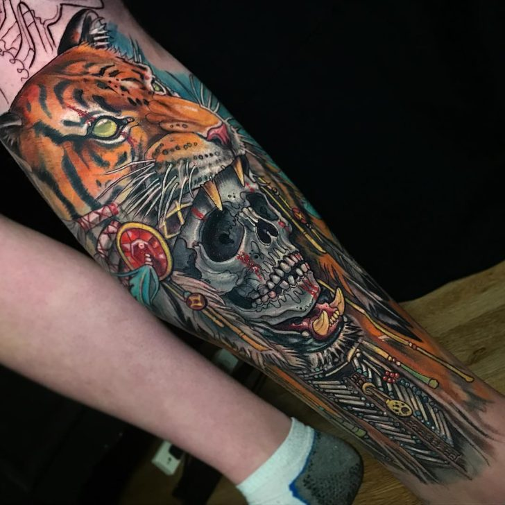 arm tattoo skull in tiger's mouth
