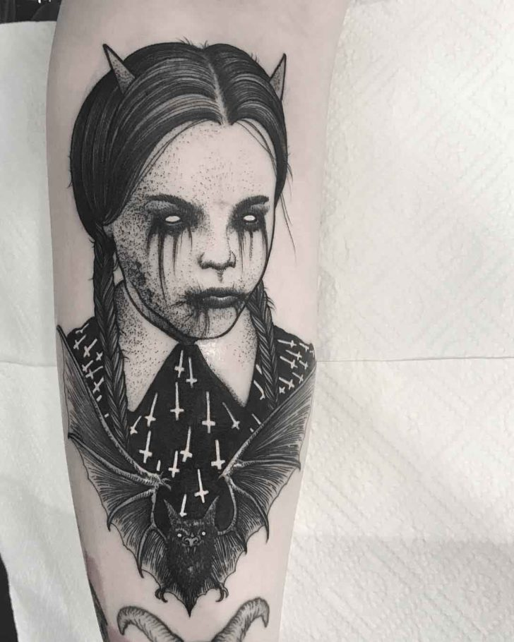 arm tattoo wenesday addams demonic