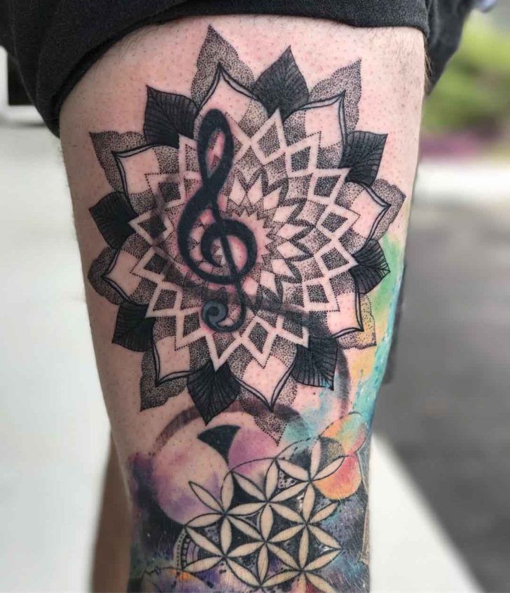 thigh tattoo treble clef in mandala