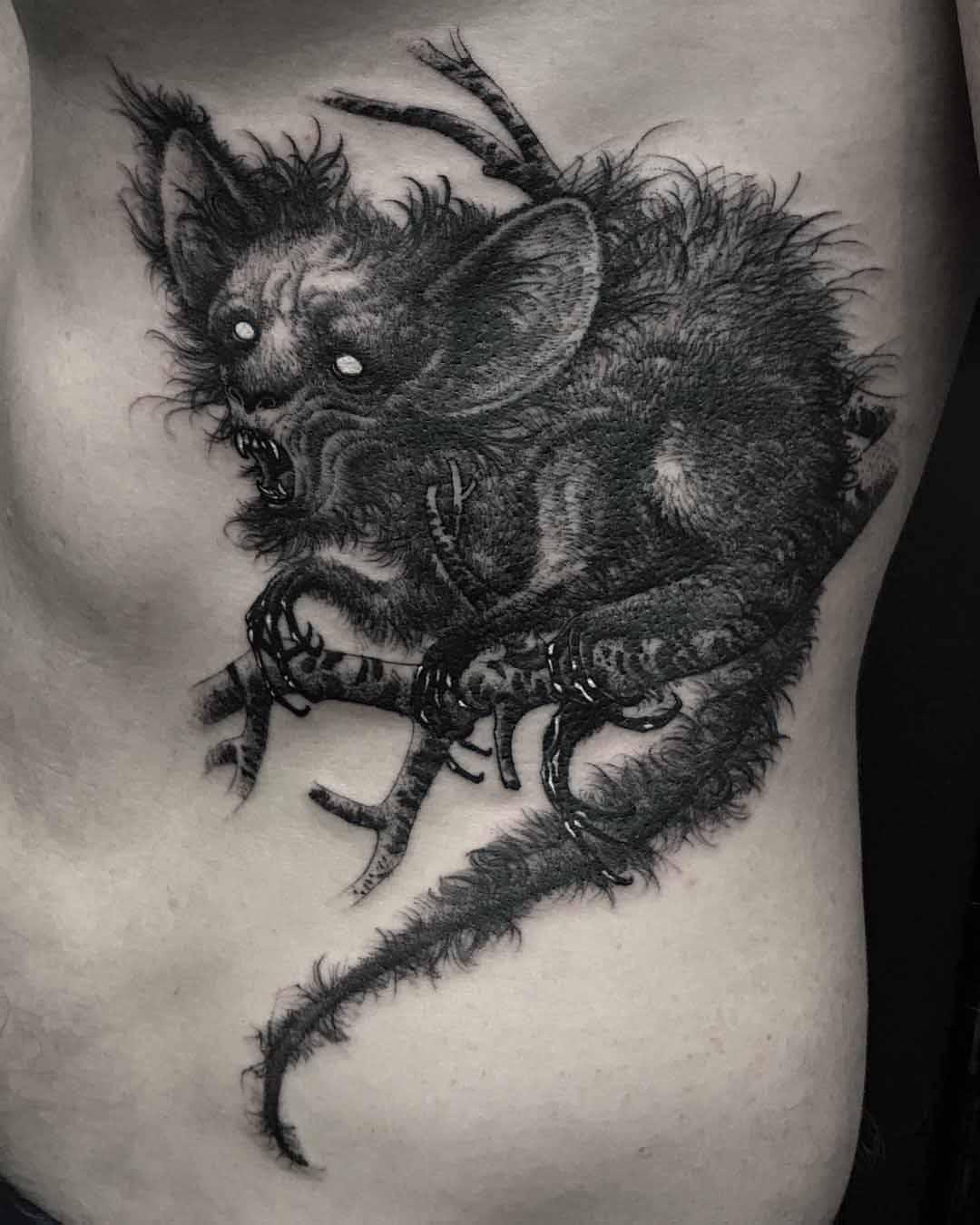 rib tattoo chupacabra monster