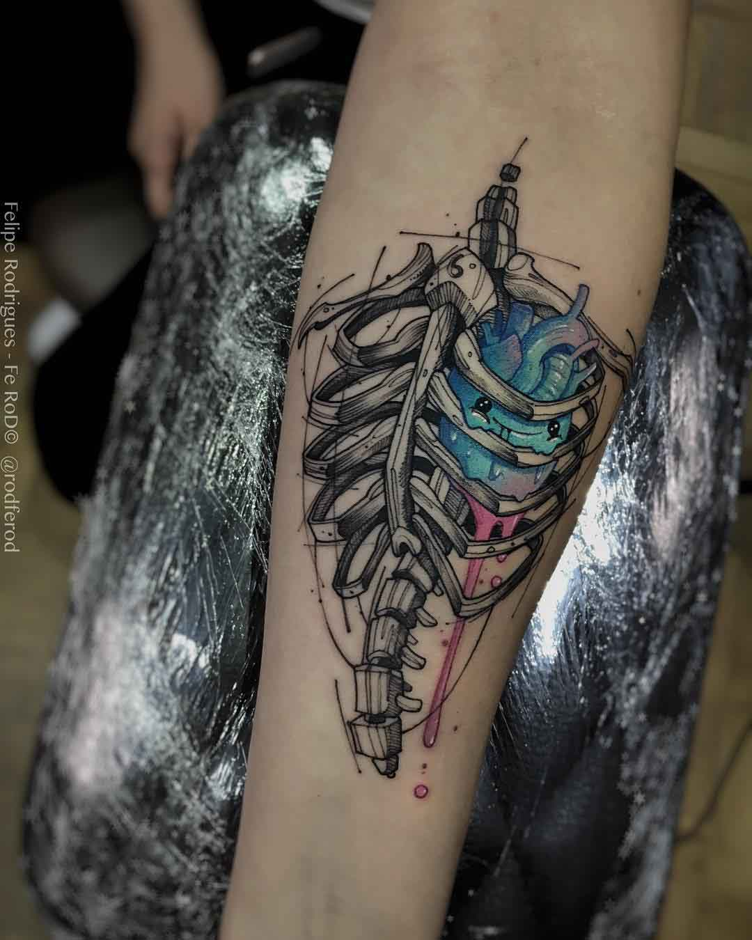 rib cage heart tattoo on arm