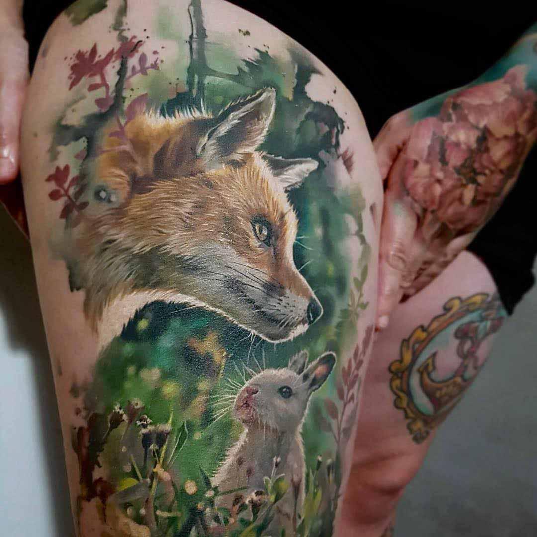 hip tattoo fox and rabbit