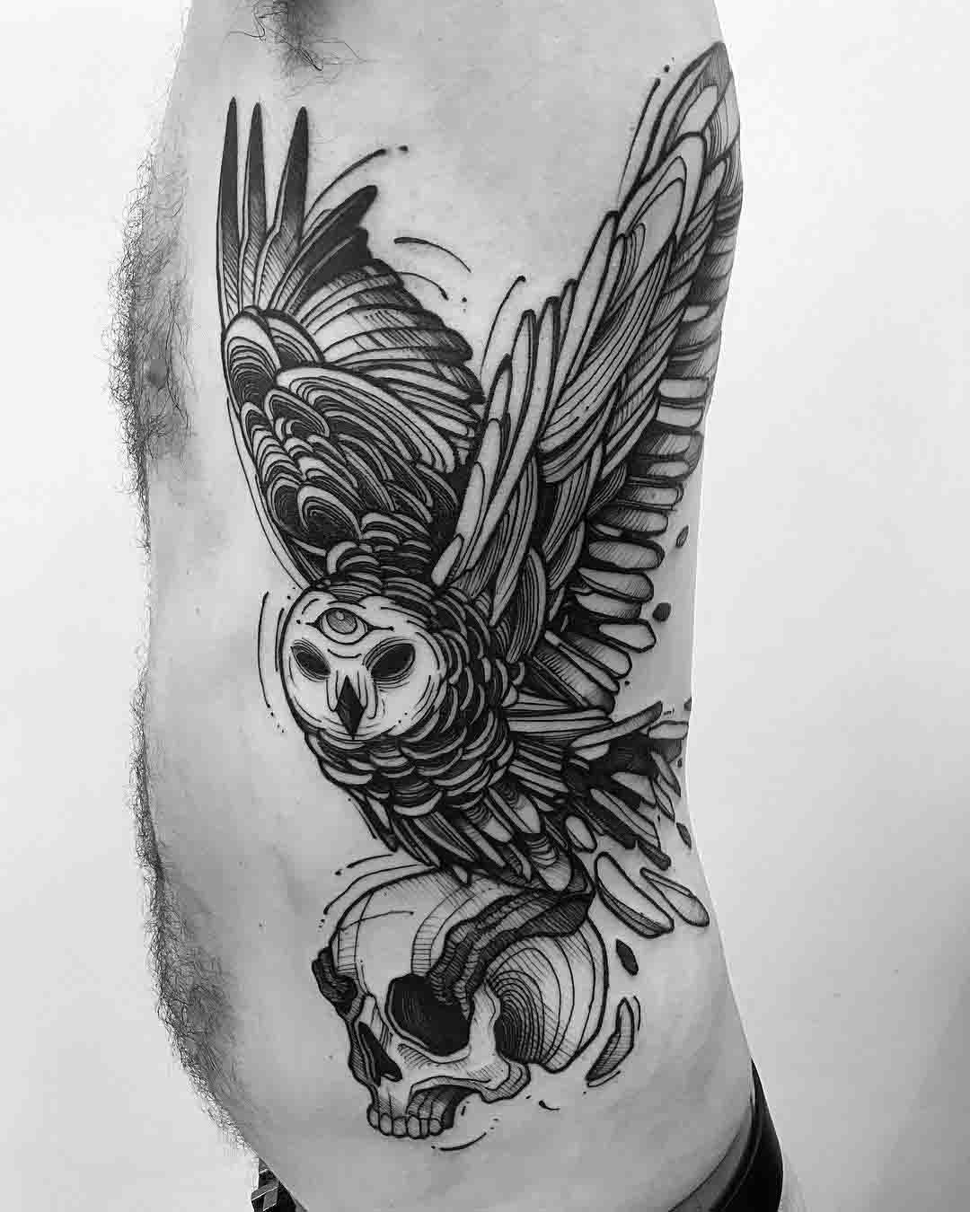torso side tattoo owl and skull